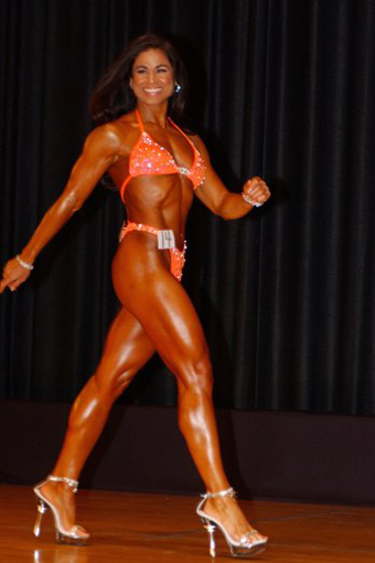 Tara Marie competition orange swimsuit