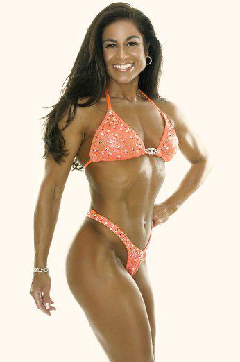 Tara Marie modeling orange swimsuit