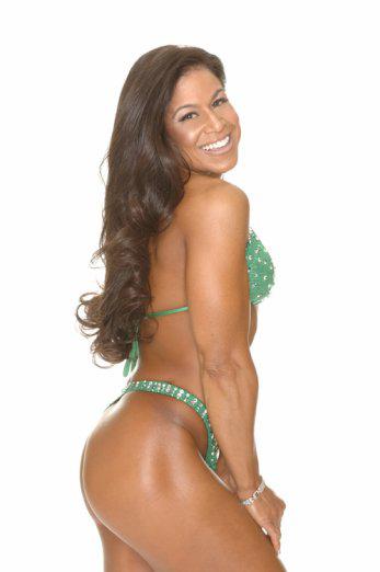 Tara Marie modeling green swimsuit