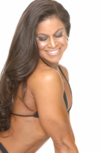 Tara Marie posing in black swimsuit