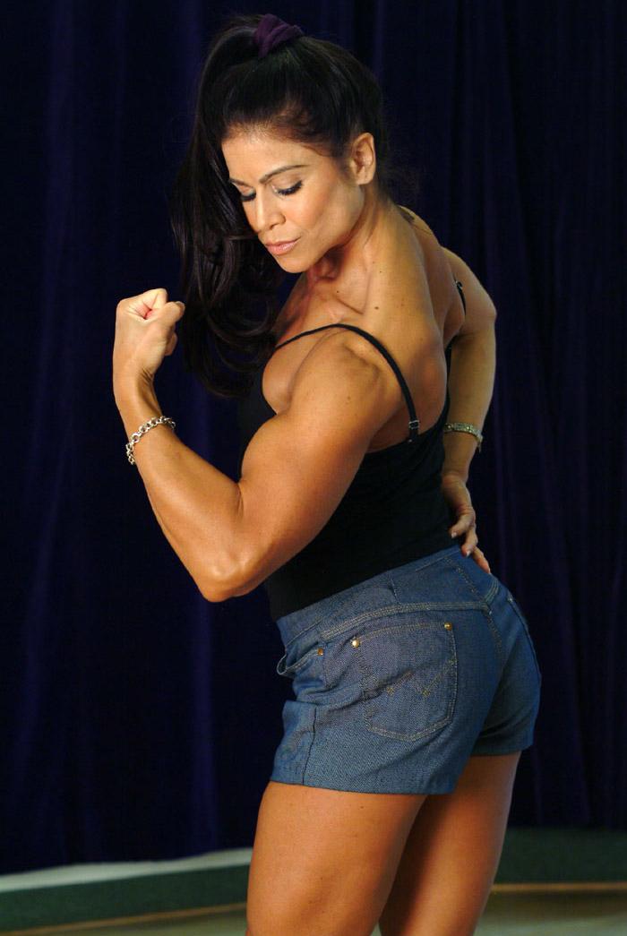 Tara Marie posing biceps
